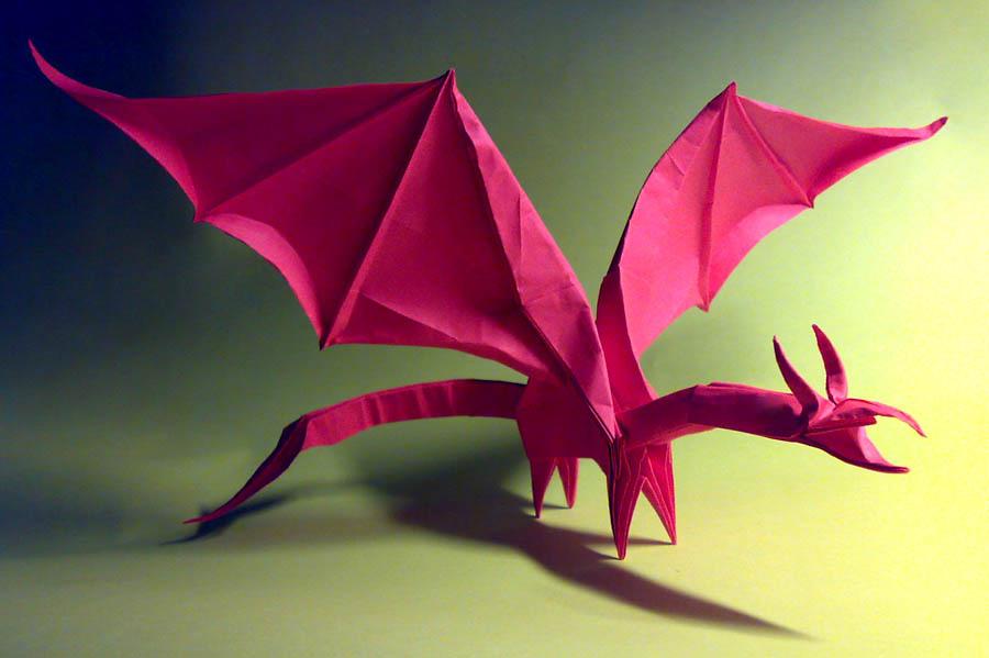Складывать драконов из бумаги